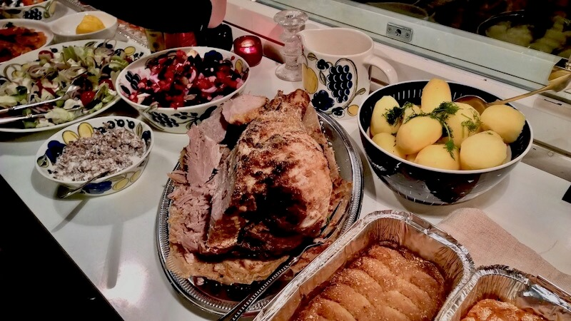 Christmas Eve Dinner is served with traditional ham steak, potatoes, vegetable boxes, mushroom salad, green salads.